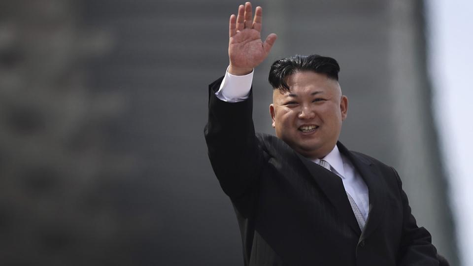 North Korean leader Kim Jong Un waves during a military parade on April 15, 2017, in Pyongyang, North Korea. (Wong Maye-E / AP)