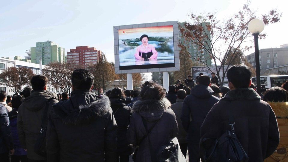 People watch the news broadcast announcing the Hwasong-15 missile test in Pyonyang, North Korea, on Nov. 29, 2017. (Jon Chol Jin / AP)