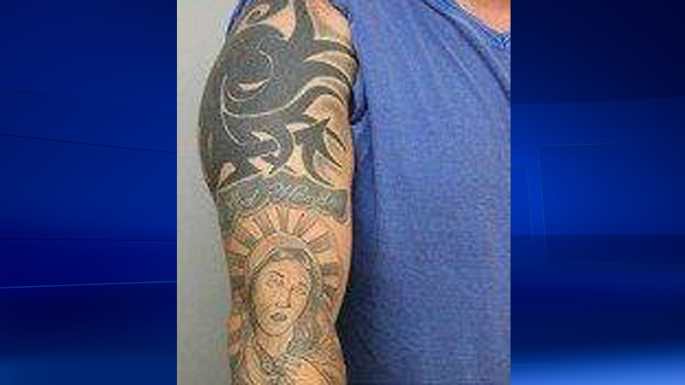 Police issued this photo of Frederick Silva's  tattoo on his right arm