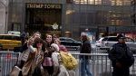 In this Wednesday, Nov. 16, 2016 photo, a group of women pose for a selfie outside Trump Tower in New York. (Muhammed Muheisen/AP Photo)