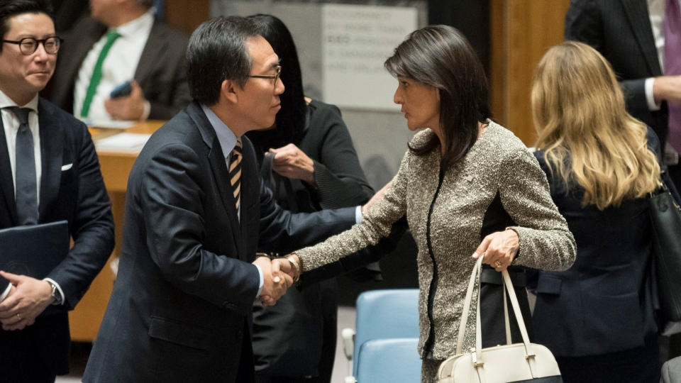American Ambassador to the United Nations Nikki Haley, right, shakes hands with South Korean Ambassador to the United Nations Cho Tae-yul after a Security Council meeting on the situation in North Korea, Wednesday, Nov. 29, 2017, at United Nations headquarters. (AP Photo/Mary Altaffer)