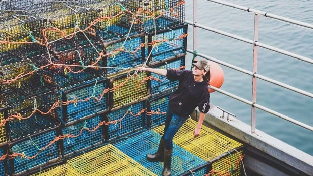 Karissa Lindstrand, shown in a handout photo, was banding lobster claws on the boat Honour Bound off Grand Manan on Nov 21, 2017 when she came across one with the image of a Pepsi can on it. (THE CANADIAN PRESS/HO-Karissa Lindstrand)