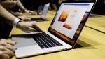A MacBook is shown during an announcement of new products at the Apple Worldwide Developers Conference Monday, June 5, 2017, in San Jose , Calif. (AP Photo/Marcio Jose Sanchez)
