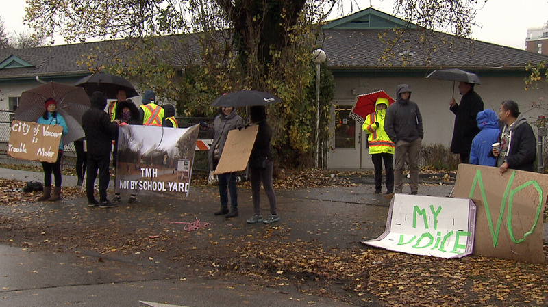 Protesters block construction crews from entering the site of a planned homeless housing project in Vancouver's Marpole neighbourhood.