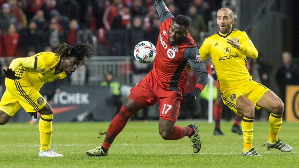 Toronto FC forward Jozy Altidore, centre, battles for the ball with Columbus Crew forward Federico Higuain, right, and defender Lalas Abubakar during first half MLS Eastern Conference final soccer action in Toronto on Wednesday, November 29, 2017. THE CANADIAN PRESS/Chris Young