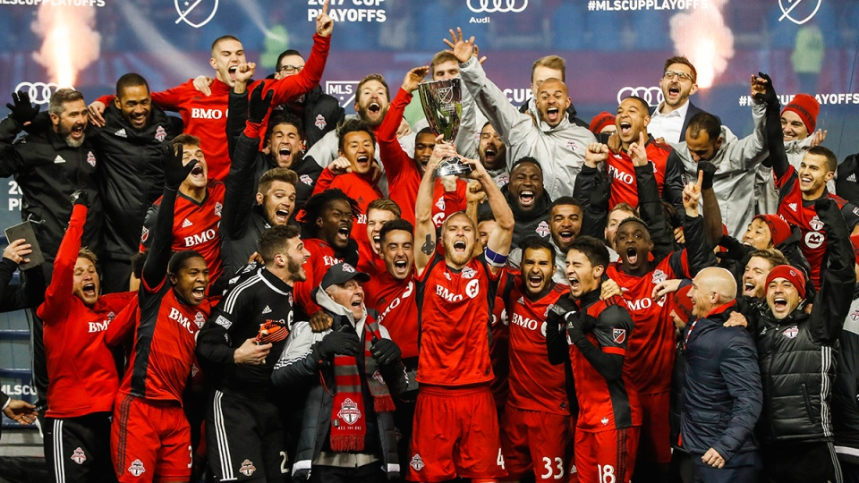 Toronto FC players celebrate with the trophy after defeating the Columbus Crew in the MLS eastern conference final in Toronto on Wednesday, Nov. 29, 2017. (Mark Blinch / THE CANADIAN PRESS)