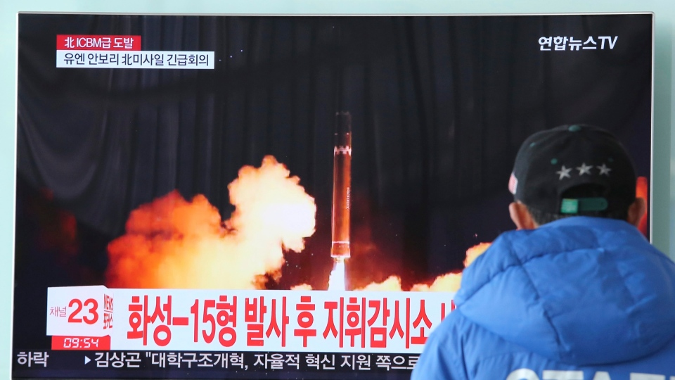 A man watches a TV screen showing what the North Korean government calls the Hwasong-15 intercontinental ballistic missile, at the Seoul Railway Station in Seoul, South Korea, Thursday, Nov. 30, 2017.  (AP Photo/Ahn Young-joon)