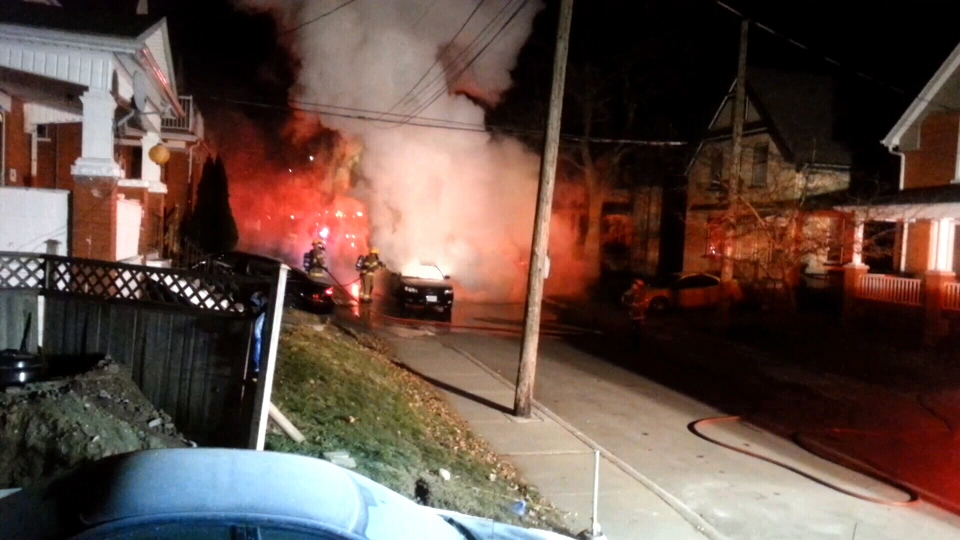 Kitchener fire crews are seen putting out a car fire on Duke Street in Kitchener, police are treating it as suspicious. (Bryan Zettler)