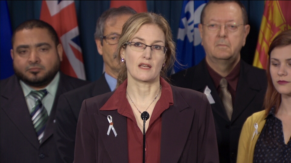 Heidi Rathjen, a survivor of the École Polytechnique shooting, accompanied by other survivors and family members of victims of gun violence in Ottawa, Thursday, Nov. 30, 2017.