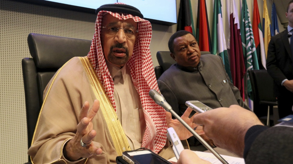 Khalid Al-Falih, Minister of Energy, Industry and Mineral Resources and President of the OPEC Conference of Saudi Arabia, left, and Mohammad Sanusi Barkindo, OPEC Secretary General of Nigeria at OPEC headquarters in Vienna, Austria, on Nov. 30, 2017. (Ronald Zak / AP)