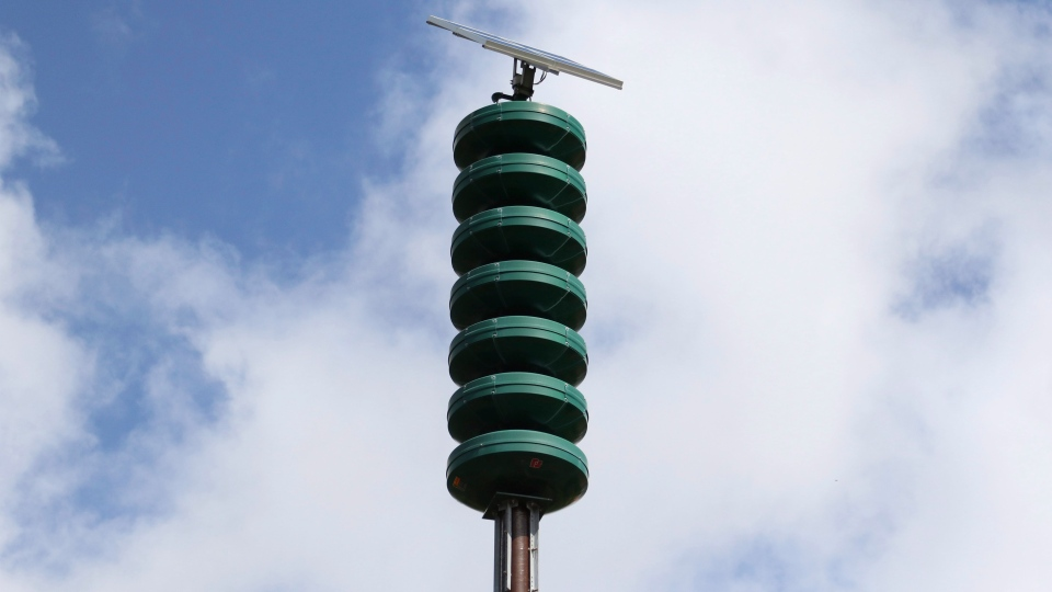 A Hawaii Civil Defense Warning Device, which sounds an alert siren during natural disasters, is shown in Honolulu on Wednesday, Nov. 29, 2017. (AP Photo/Caleb Jones)