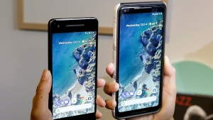 In this Wednesday, Oct. 4, 2017, file photo, a woman holds up the Google Pixel 2 phone, left, next to the Pixel 2 XL phone at a Google event at the SFJAZZ Center in San Francisco. (AP Photo/Jeff Chiu, File)