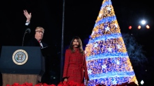 President Donald Trump with first lady Melania Trump waves as they leave the lighting ceremony for the 2017 National Christmas Tree on the Ellipse near the White House in Washington, Thursday, Nov. 30, 2017. (AP Photo/Manuel Balce Ceneta)