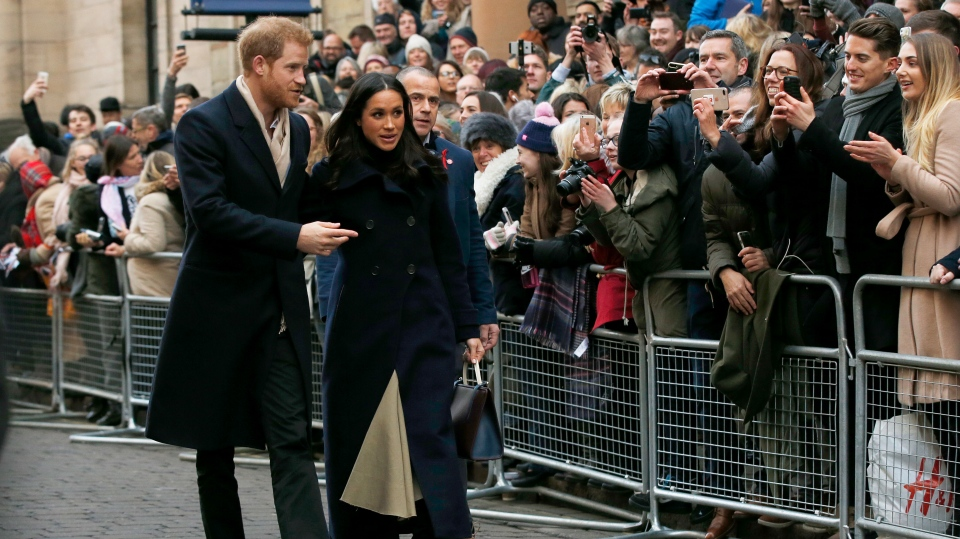 Prince Harry and his fiancee Meghan Markle arrive at the Terrence Higgins Trust World AIDS Day charity fair, in Nottingham, England, Friday, Dec. 1, 2017. (AP Photo/Alastair Grant)