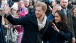 Britain's Prince Harry and his fiancee Meghan Markle, on their first official public engagement, take part in a walkabout en route to visiting the Terrence Higgins Trust World AIDS Day charity fair at the Contemporary Centre in Nottingham, England, Friday Dec. 1, 2017. (AP Photo/Rui Vieira)