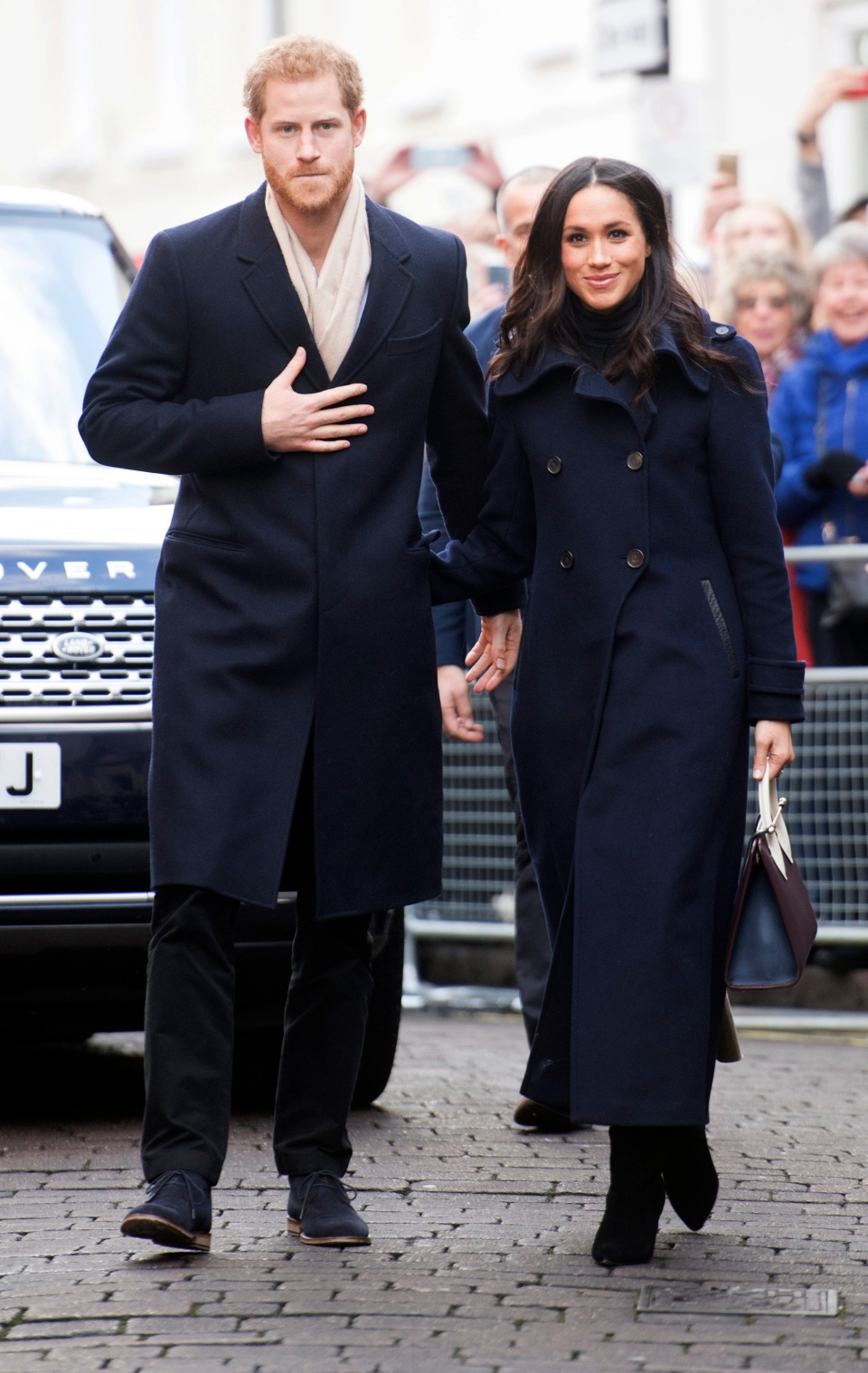 Prince Harry and his fiancee Meghan Markle, on their first official public engagement in Nottingham, England, Friday Dec. 1, 2017. (Jeremy Selwyn / Pool Photo via AP)