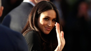 Meghan Markle waves as she leaves with Prince Harry after watching a hip hop opera performance by young people involved in the Full Effect programme at the Nottingham Academy school in Nottingham, England, Friday Dec. 1, 2017. (AP Photo/Matt Dunham)