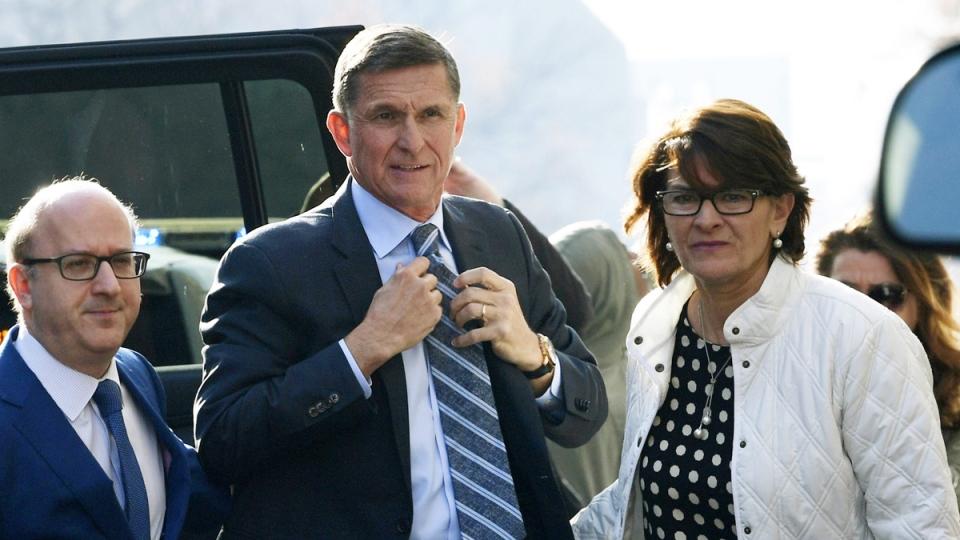 Former Trump national security adviser Michael Flynn, centre, arrives at federal court in Washington, on Dec. 1, 2017. (Susan Walsh / AP)