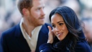 Meghan Markle arrives with Britain's Prince Harry at the Nottingham Contemporary to attend a Terrence Higgins Trust World AIDS Day charity fair, in Nottingham, England, Friday, Dec. 1, 2017. The couple are taking part in their first official visit together, choosing to raise awareness of HIV/AIDS with a visit to a youth project in Nottingham. (Adrian Dennis/Pool Photo via AP)