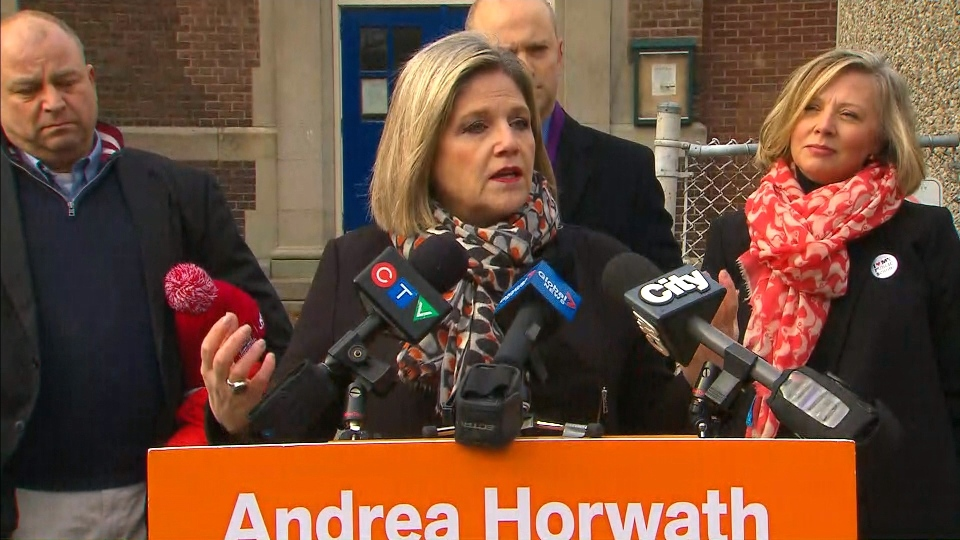 NDP Leader Andrea Horwath speaks with reporters outside Dovercourt Public School on Friday.