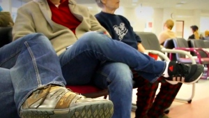 Patients are seen sitting in a hospital waiting room in this undated file photo.