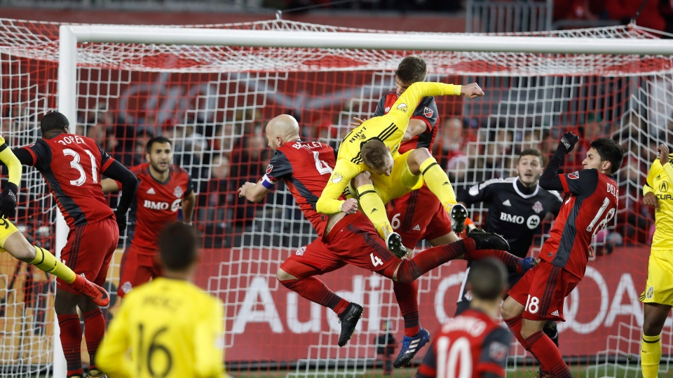 Columbus Crew's Adam Jahn battles for the ball with Toronto FC's Michael Bradley during the MLS eastern conference final playoff on Wednesday, November 29, 2017. (THE CANADIAN PRESS/Mark Blinch)