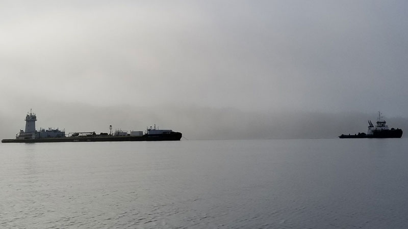 The Jake Shearer tug and fuel barge leave Heiltsuk territory on Dec. 2, 2017. (Robert Reid / Heiltsuk Tribal Council)