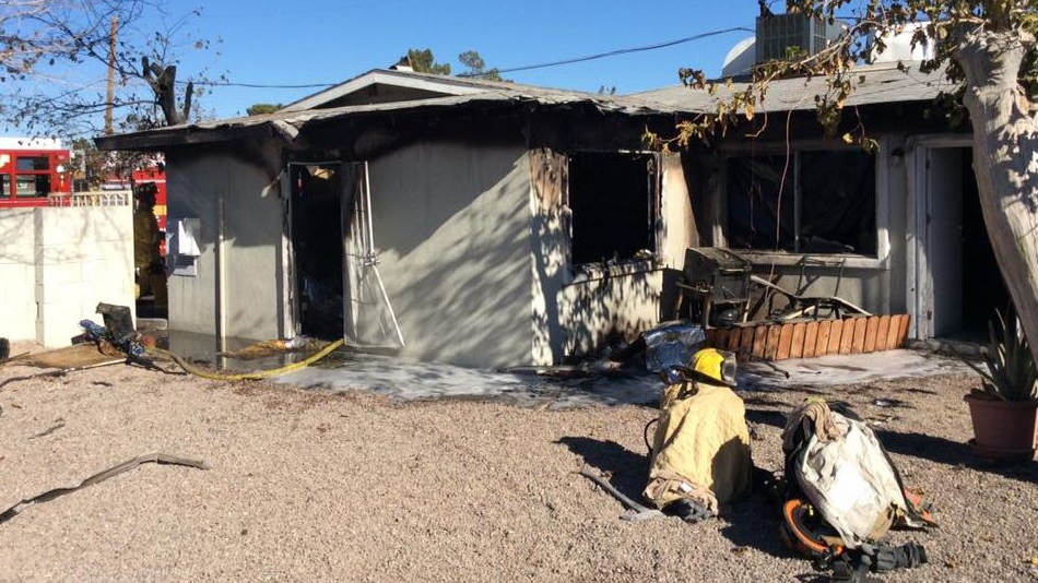 The home burst into flames when the children's grandfather was cooking, fire officials said. (Source: Las Vegas Fire & Rescue, Facebook)