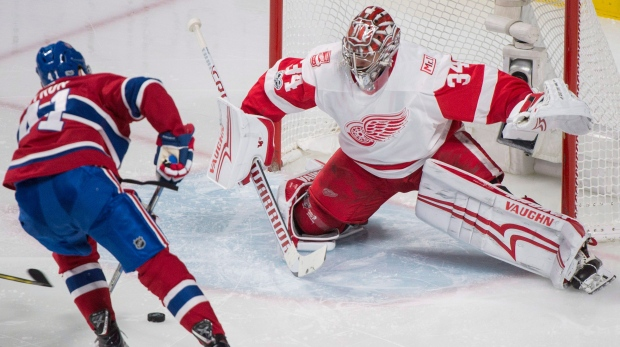 Montreal Canadiens' Paul Byron scores against Detroit Red Wings goaltender Petr Mrazek during second period NHL hockey action in Montreal, Saturday, December 2, 2017. THE CANADIAN PRESS/Graham Hughes