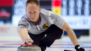Skip Brad Jacobs, of Sault Ste. Marie, makes a shot during the Canadian Olympic curling trials against team Koe, in Ottawa on Sunday, December 3, 2017. (Adrian Wyld/THE CANADIAN PRESS)