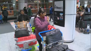 After their last-ditch appeals for reprieve were unsuccessful, the Lawrence family boarded a plane bound for their native country of Sri Lanka. (CTV Montreal)