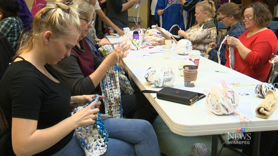In this photo, volunteers crochet mats for the homeless out of plastic bags. (CTV Winnipeg)