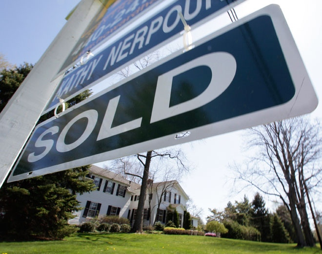 A sold sign hangs outside an existing home that was for sale on Monday, April 27, 2009. (AP / Amy Sancetta)