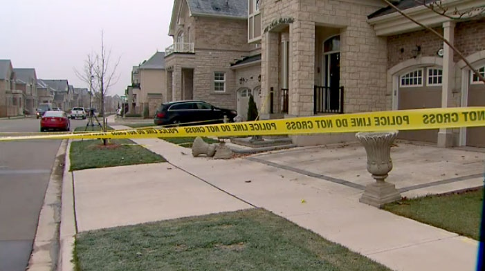 Police tape blocks off a residential home in Oakville where a man was found shot to death on Dec. 3, 2017.