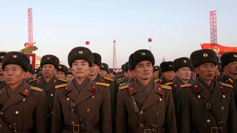 Military personnel gather at Kim Il Sung Square in Pyongyang, North Korea on Friday Dec. 1, 2017. (AP Photo/Jon Chol Jin)