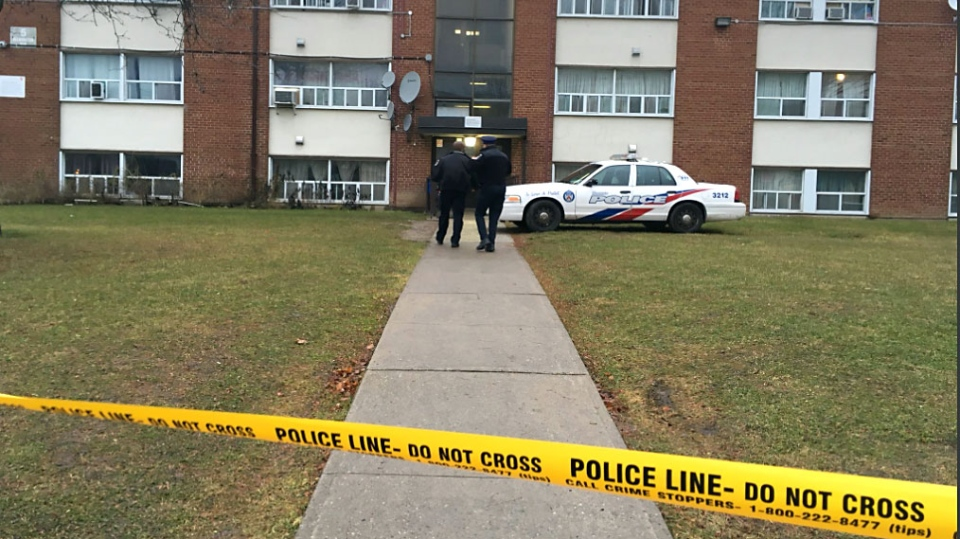 Police investigators at the scene of a fatal fire at a Toronto Community Housing Building in Lawrence Heights on Dec. 5, 2017. (Christie Bezaire/CP24)