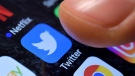 A close-up image showing the Twitter app on an iPhone. (EPA/SASCHA STEINBACH)