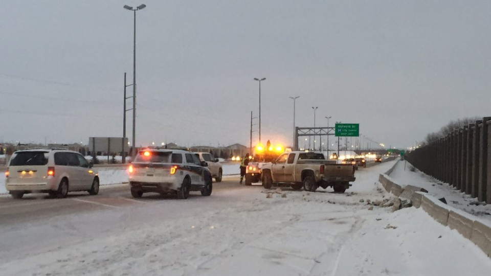 Saskatoon emergency crews and a tow truck respond Tuesday, Dec. 5, 2017, after a crash on Circle Drive. (Mark Villani/CTV Saskatoon)