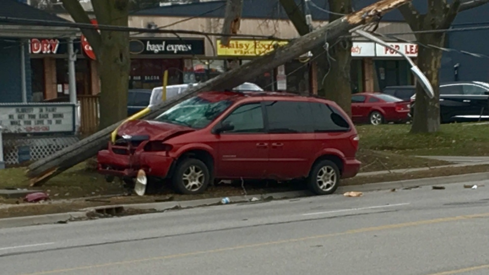 Van slams into a hydro pole on Oxford Street near Adelaide St. on Dec. 5, 2017. (Jim Knight/CTV)