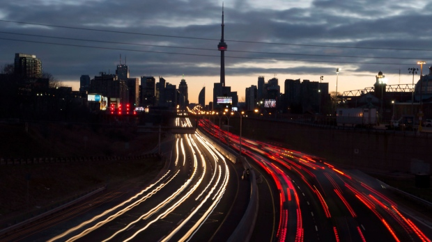 The headlights and tail lights of vehicles are shown as commuters travel into Toronto on the Gardiner Expressway in the early morning hours of Friday January 27, 2017. The Canadian Press has learned Ontario Premier Kathleen Wynne will deny the mayor of Toronto's request to impose tolls on two major highways. THE CANADIAN PRESS/Frank Gunn