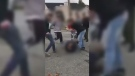 A video of teens brawling at a Duncan high school that is circulating on social media has sparked accusations of racism online. Dec. 4, 2017. (Facebook)