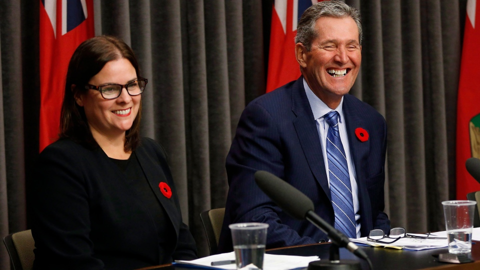 Justice Minister Heather Stefanson from left, Manitoba Premier Brian Pallister and Growth, Enterprise and Trade Minister Blaine Pedersen react after being asked if they have ever tried cannanis during an announcement of the Manitoba plan for cannabis retail and distribution at the Manitoba Legislature in Winnipeg, Tuesday, November 7, 2017. (THE CANADIAN PRESS/John Woods)
