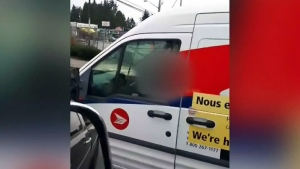 Canada Post is looking into a video that appears to show a driver involved in an incident of road rage.