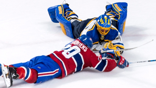 St. Louis Blues goalie Jake Allen and Montreal Canadiens' Nicolas Deslauriers dive for the puck during second period NHL hockey action in Montreal on Tuesday, December 5, 2017. THE CANADIAN PRESS/Paul Chiasson