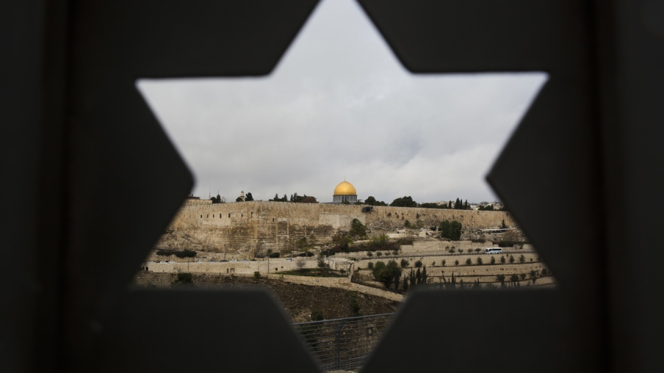 Jerusalem Old City is seen through a door with the shape of star of David, on Dec. 6, 2017. (Oded Balilty / AP)