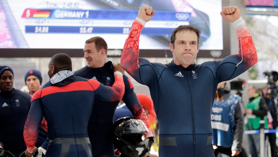 In this file photo, the team from Great Britain, with John James Jackson, right, Stuart Benson, Bruce Tasker and Joel Fearon, react after their final four-man bobsled run during at the 2014 Winter Olympics in Russia. (AP Photo/Jae C. Hong, File)