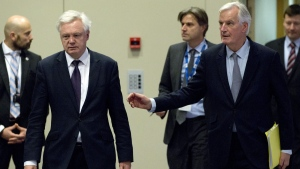 British Secretary of State for Exiting the European Union David Davis, second left, and European Union chief Brexit negotiator Michel Barnier in Brussels on Dec. 4, 2017. (Virginia Mayo / AP)