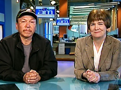 Faron Hall, left, who rescued a teen from the Red River, and Marion Willis, who witnessed the rescue, speak on Canada AM from CTV's studios in Winnipeg, Wednesday, May 6, 2009.