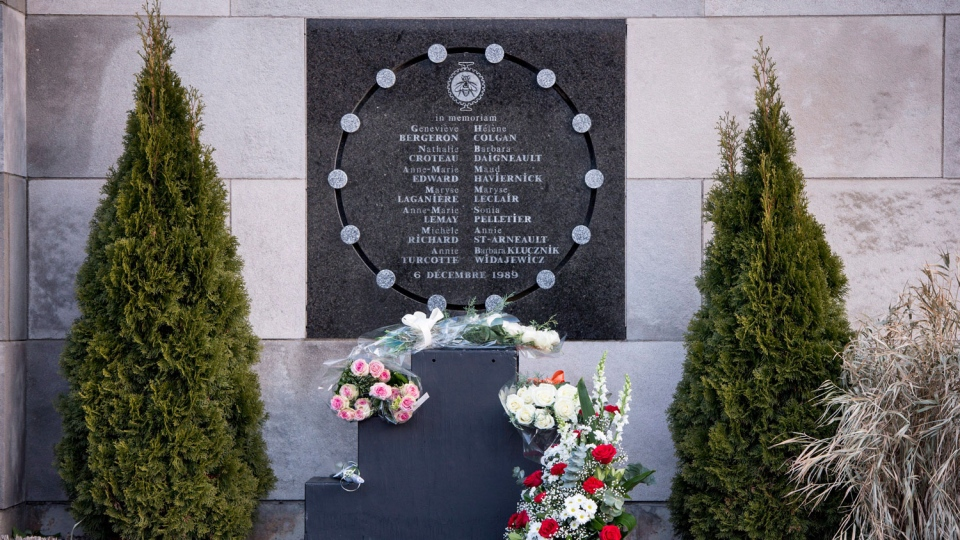 Flowers are seen at the commemorative plaque during a ceremony marking the 28th anniversary of the Montreal Massacre when a gunman shot 14 women to death and injured 14 other people Wednesday, December 6, 2017 in Montreal. THE CANADIAN PRESS/Paul Chiasson