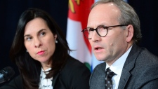 Quebec Public Security Minister Martin Coiteux and Montreal Mayor Valerie Plante attend a news conference in Montreal, Wednesday, Dec.6, 2017. THE CANADIAN PRESS/Paul Chiasson